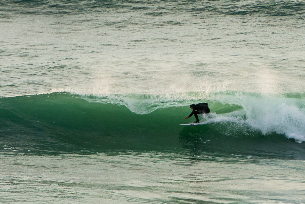 Surfer is barrelled at Watergate Bay