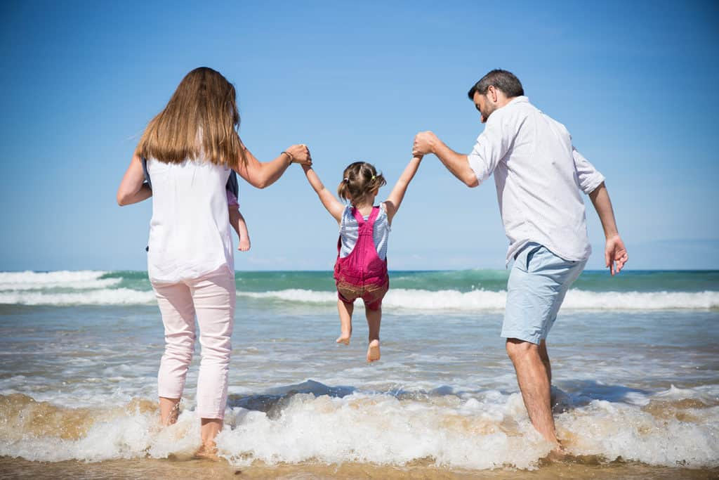 family photographer jump waves